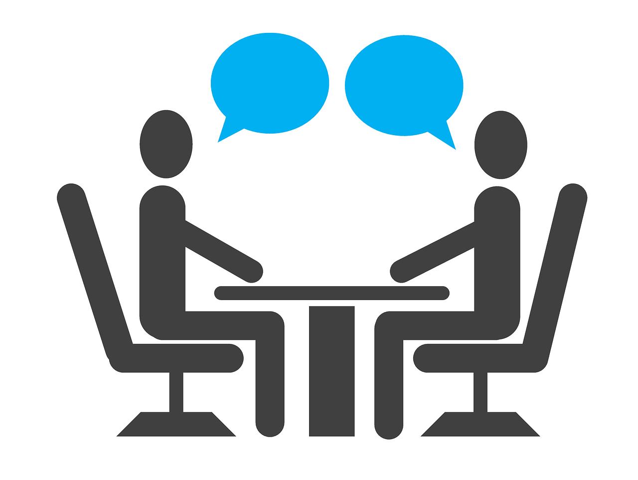 persone sedute per decidere come creare sito